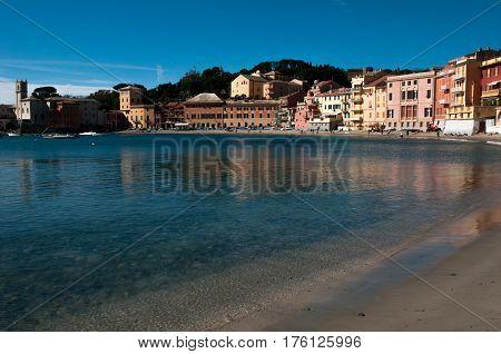 view of 'baia del silenzio' in sestri levante genoa on a blue sky background