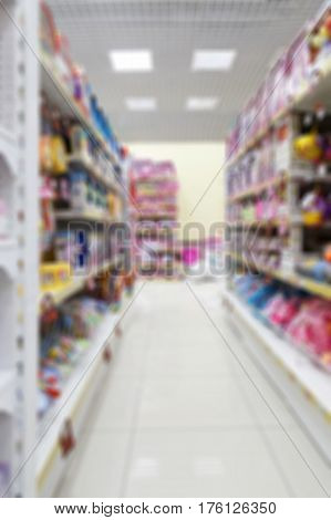 Vertical Blurred Background Image Of Supermarket Or Shopping Mall.