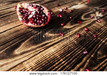 a garnet grains, grenades on wooden background