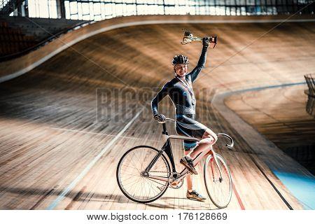 Smiling sportsman on a velodrome