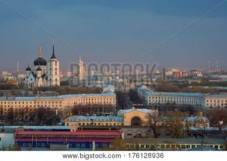 Cloudy evening Voronezh cityscape, railway station, cathedral, railway management tower with clock