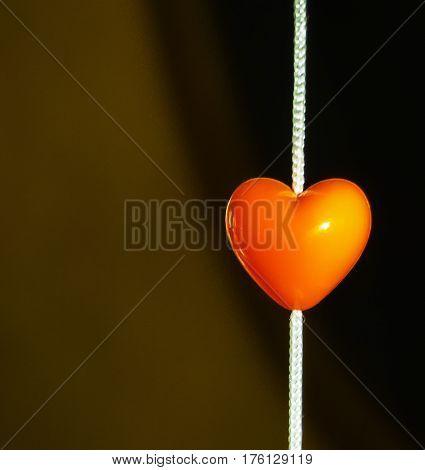Wonderful red heart toy on the dark background