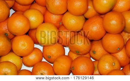 Many light orange mandarins on the box