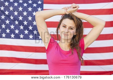 cheerful american woman isolated on a United States of America flag