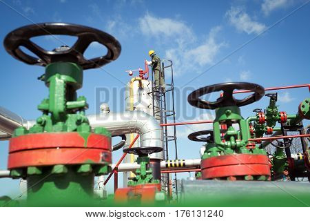 Oil engineer inside fuel industry on the blue sky