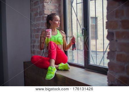 beautiful young girl is drinking a fitness smoothie. Healthy lifestyles concept