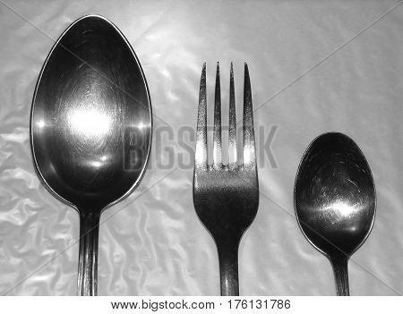 Spoons and fork on the light background
