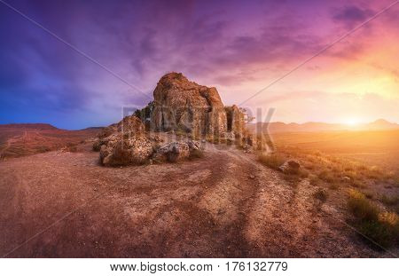 Rocks Against Amazing Cloudy Sky In Desert At Sunset