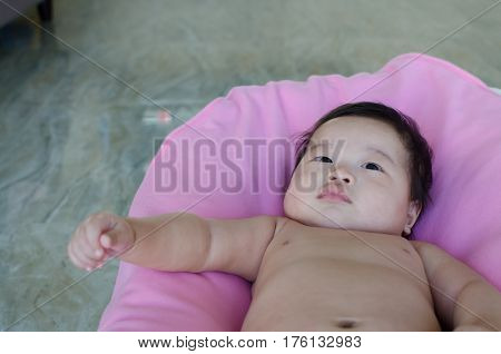 Fat and cute baby sleepy o the pink blanket.