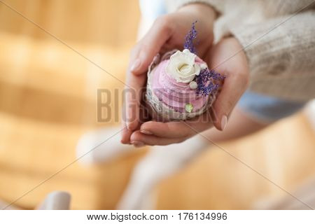 Cake with cream in hands. view from above