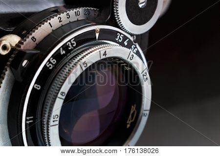 Retro camera lens close up on dark background
