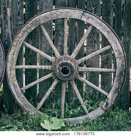 Old Wooden Cart Wheel in the village