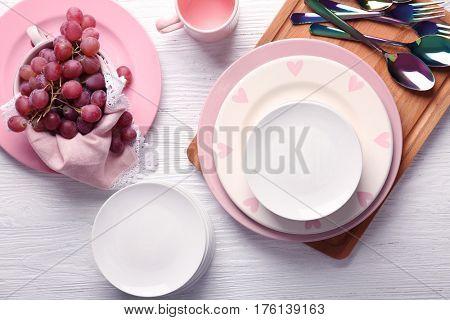 Set of dinnerware on white wooden table