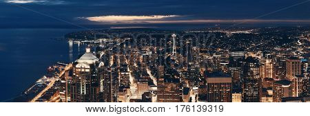 Seattle rooftop panorama view with urban architecture at night.