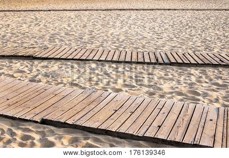 boardwalk on a sandy beach by the sea