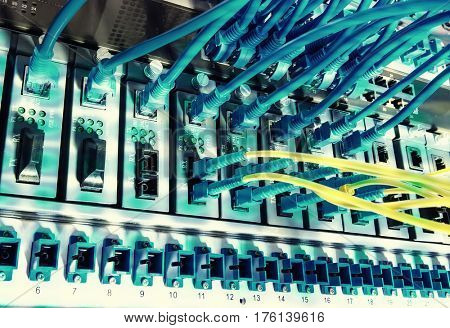 cables connected to an optic ports and Ethernet ports