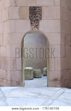 Aged narrow vaulted passage and stone bricks wall Medieval Cairo Egypt