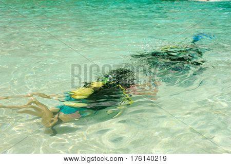 Child Discover Scuba Diving At Cala Mariolu Beach On Sardinia