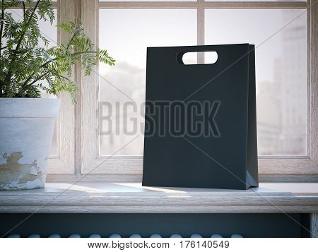 Black shopping bag on a wooden window sill. 3d rendering