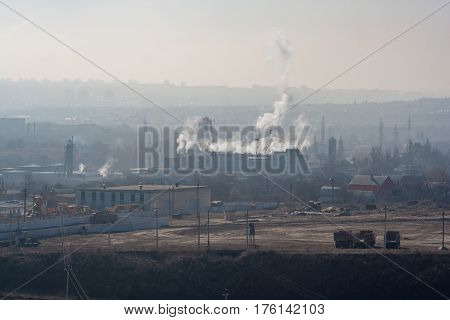 Morning, fog, smog, dirty polluted industrial area. smokesting pipes of plants