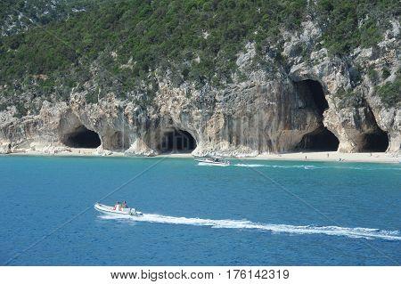 Cala Luna, Italy - 28 June 2013: a boat cruising in front of Cala Luna beach in Orosei bay on Sardinia, Italy.