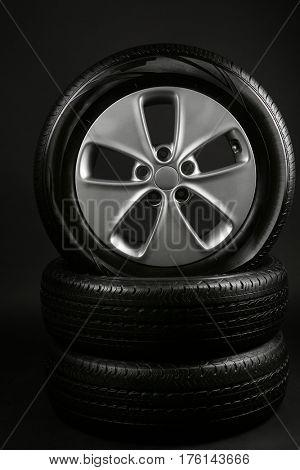 Modern car wheels on dark background