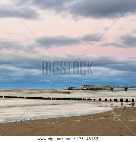 Concrete Pier In Kolobrzeg, Long Exposure Shot At Sunset