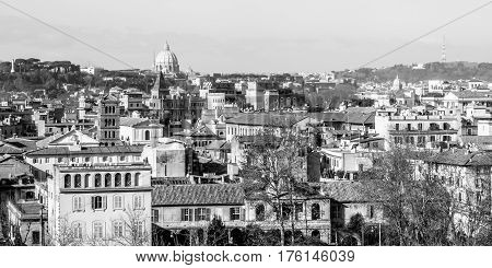 cityscape of Rome in Italy with the dome of Saint Peter church in the background in Black and White