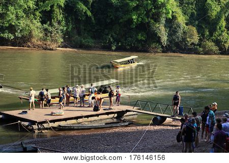 LANNA, THAILAND - DECEMBER 20: Taxi boats near pier for travelers and tourists who expect departure down to Khwae river in Thailand on December 20, 2013 in Lanna