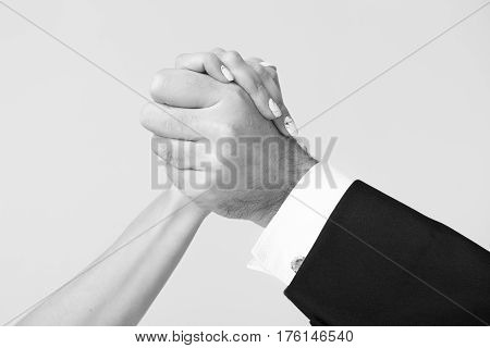 female and male hands of man and woman touch and hold each other as family in love gesture black and white