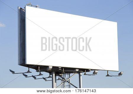 Blank metal billboard over a blue sky