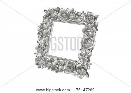 Silver picture frame with rose decor, clipping path included.