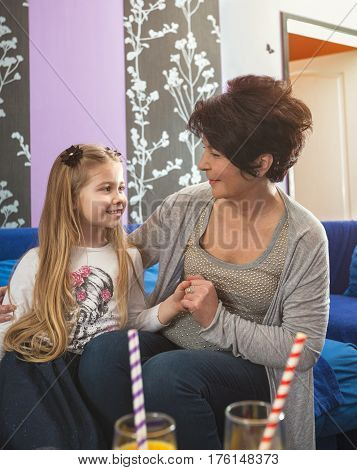 Caring grandma and granddaughter spending time together