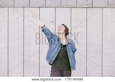positive teen androgynous woman laughing with a cheerful attitude towards life