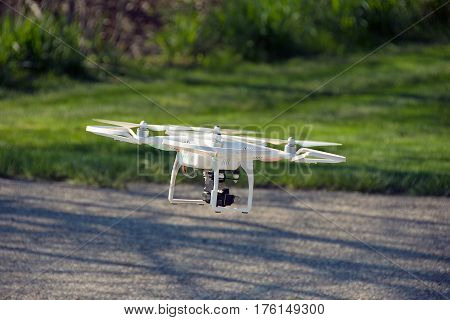 drone with video camera hovering over street