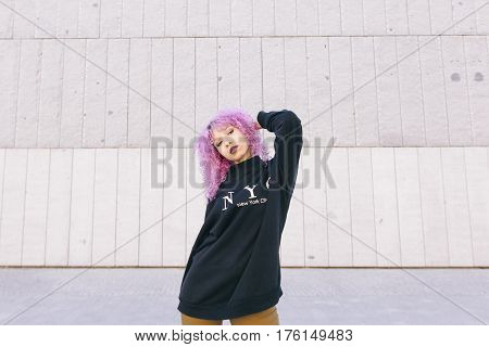 ethnic black young woman with a colorful hair and a New York sweater