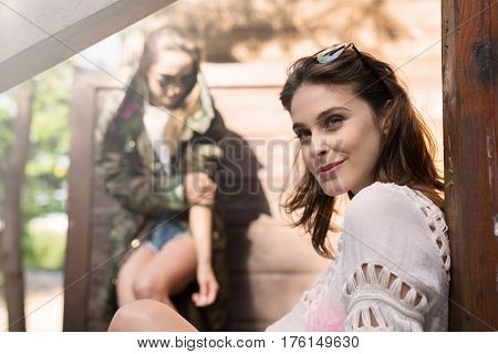 Beautiful Smiling Woman Sitting Outside With Friend