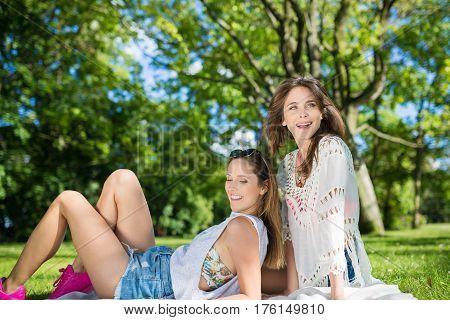 Happy Beautiful Women Relaxing In The Park