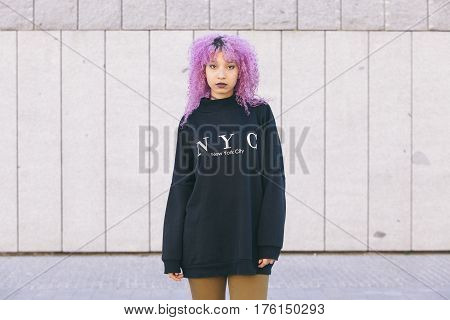 isolated young mixed race woman in the streets of New York