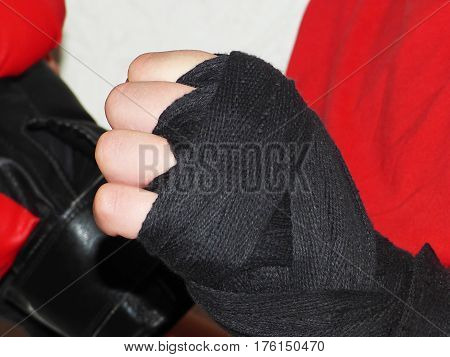 Very beautiful red boxing gloves and black bandages