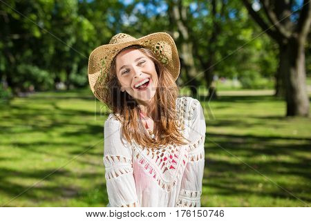 Young Beautiful Woman In Hat Laughing Outside
