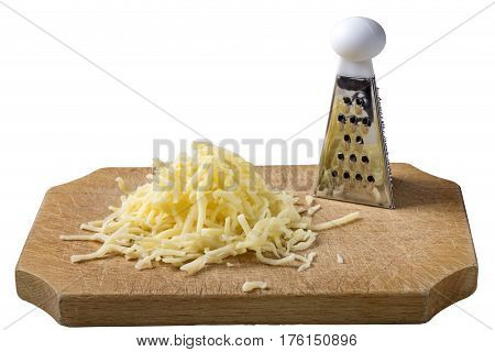 Grated cheese mix on wooden cutting board with one little grater isolated over white background with clipping path