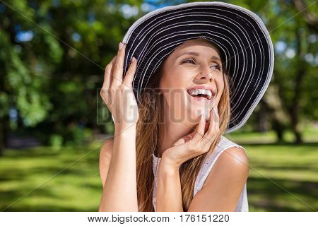 Beautiful Carefree Woman In Hat Outside Looking Away
