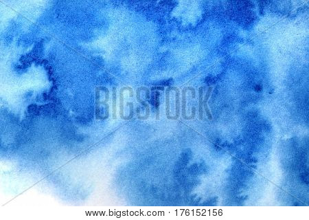 Vivid blue diffused watercolor stains. Abstract textured background