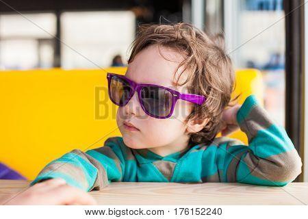 The Boy In Sunglasses.