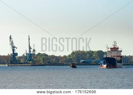 Blue cargo ship leaving the port of Riga