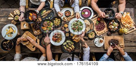 Table in a restaurant with food, top view