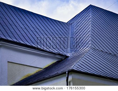 architectural background detail indented blue metal roof