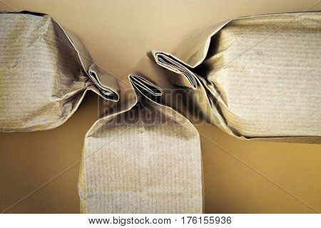 abstract background three sealed produkt paper bags