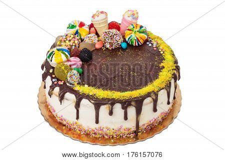 Cake decorated with marshmallows and sweets. For a birthday.